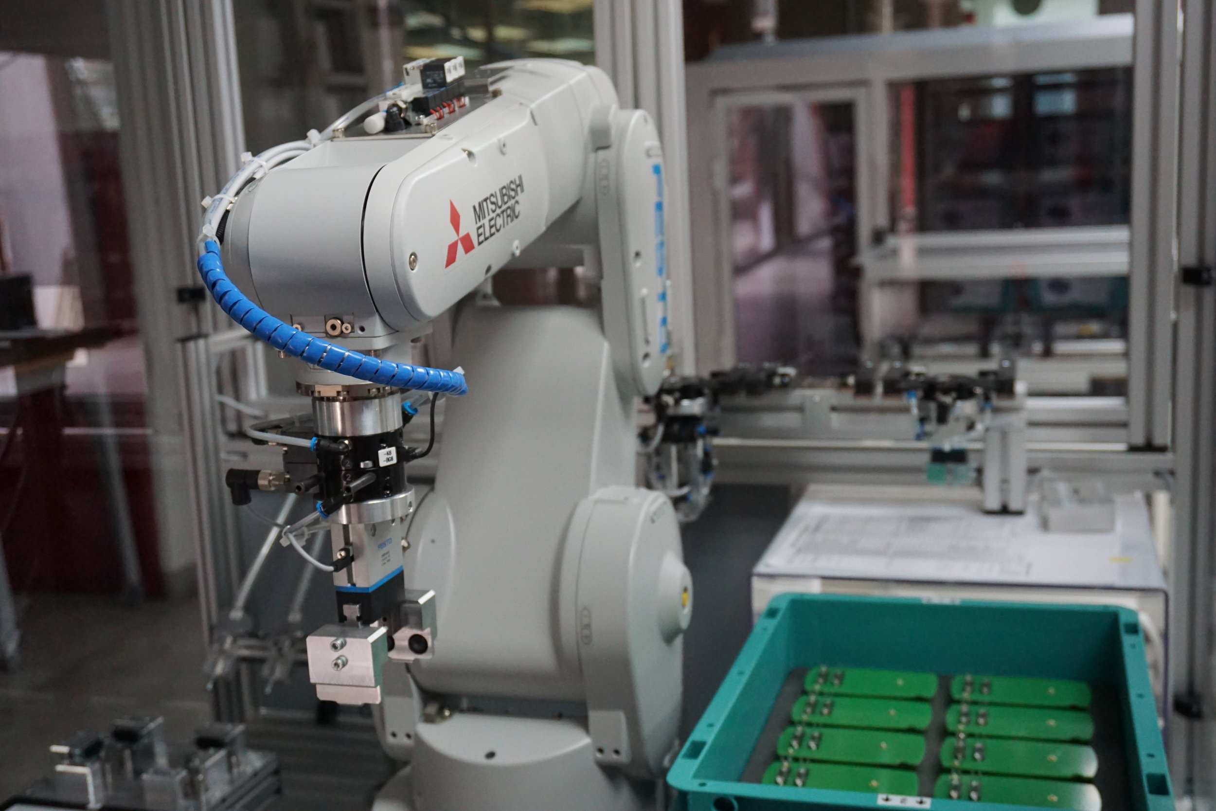 Robots such as this one are used in manufacturing for precise work.