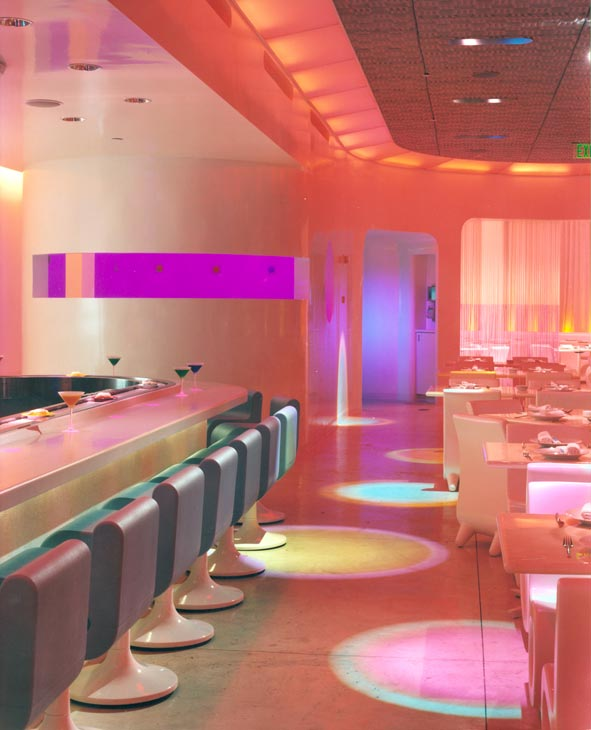 55-foot-long Corian counter,lights projected from ceiling cast colors in circular patterns on the concrete floor