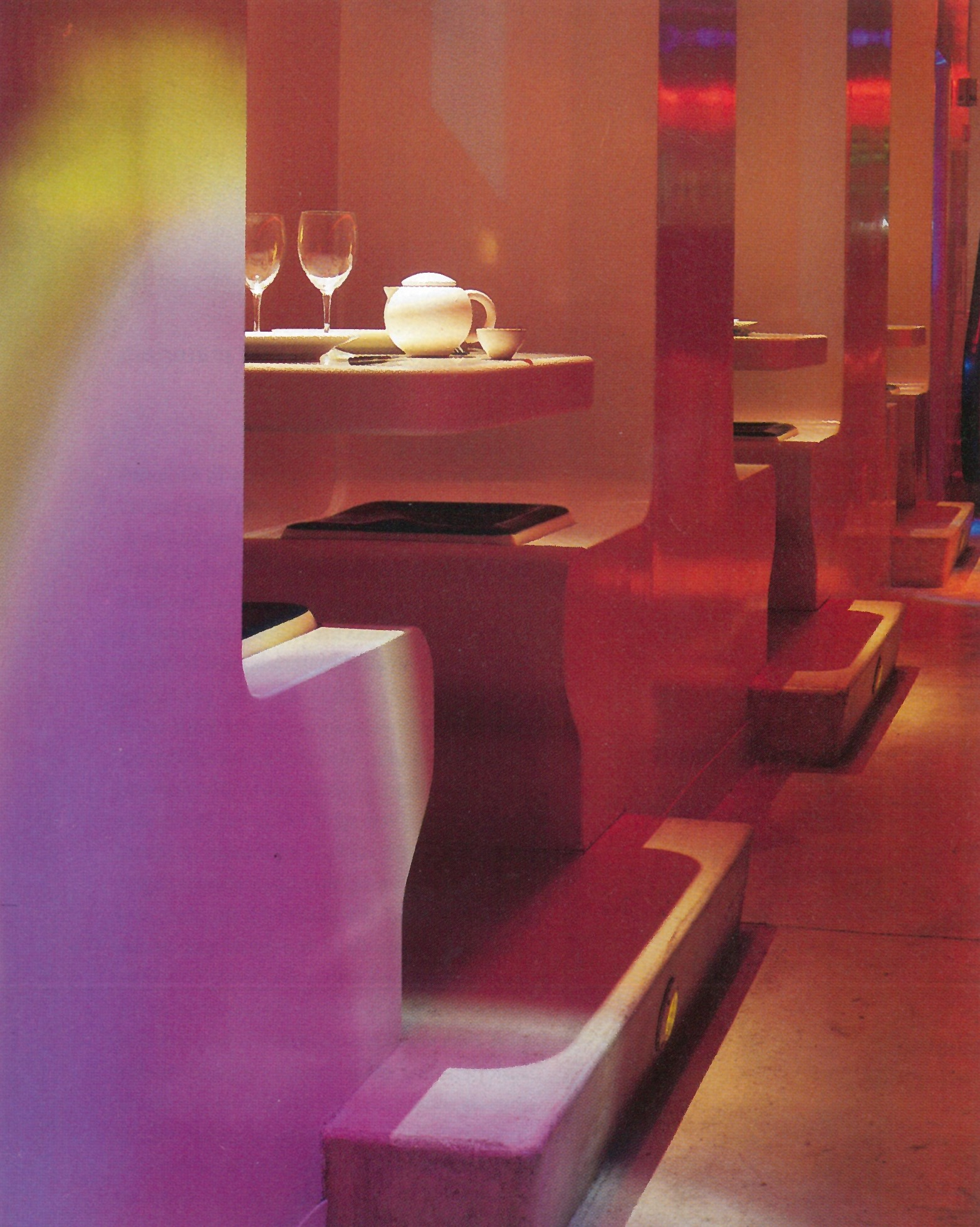 Elevated booths - Tables cantilevered to wall with gel cushions for comfortable seating