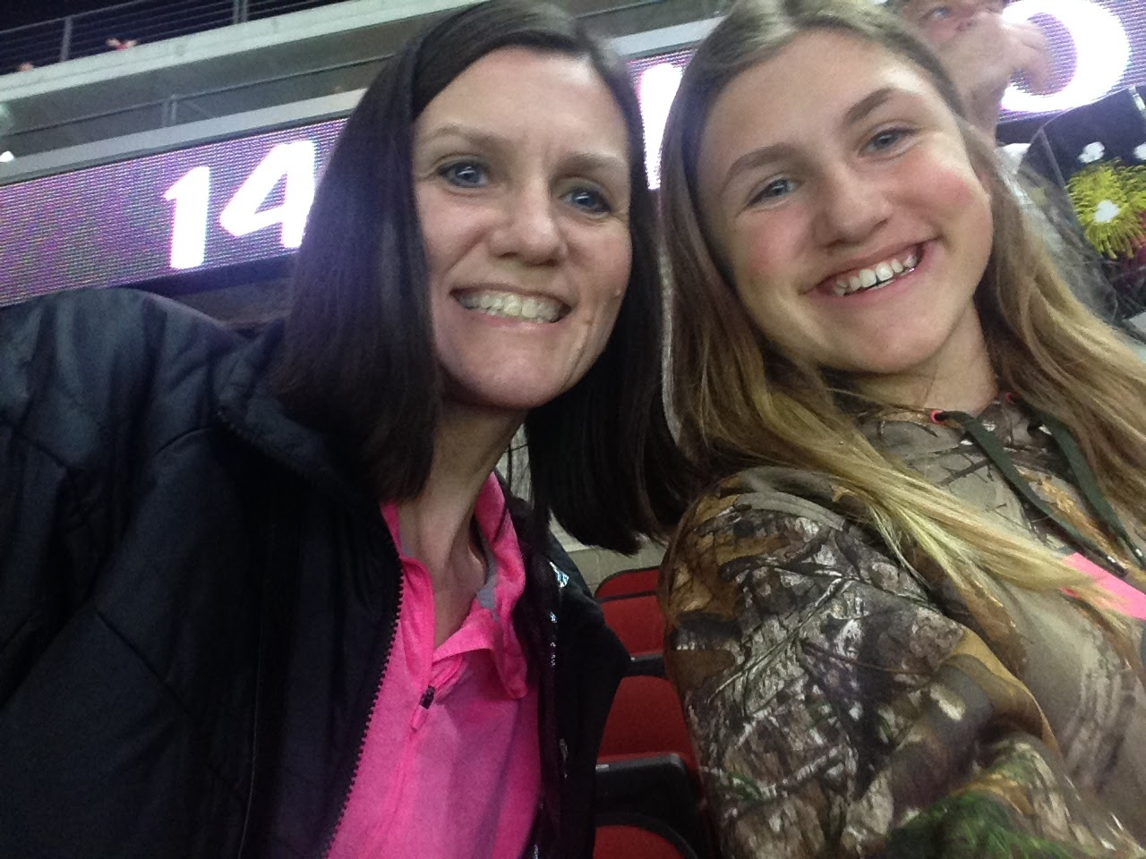 Ashlee-and-Mommy-Hockey-Game.jpg