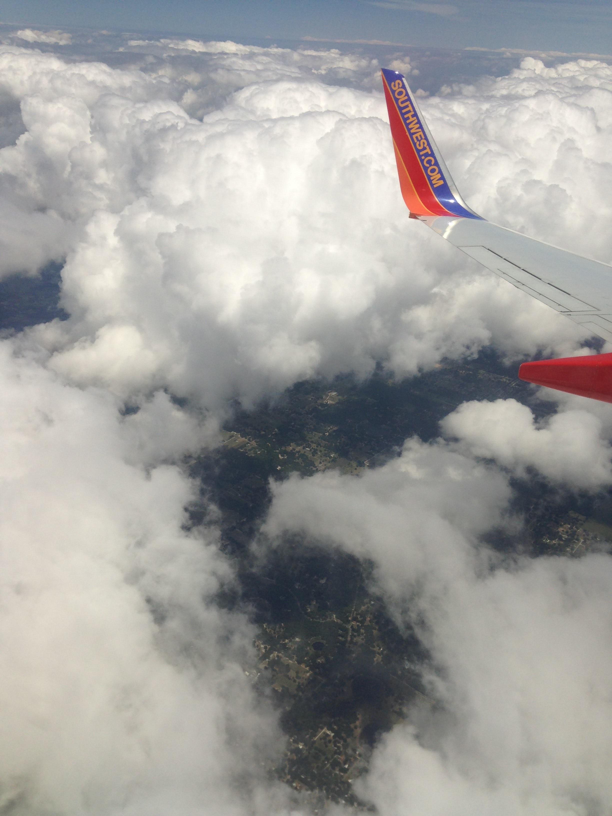 Plane-Puffy-Clouds.jpg