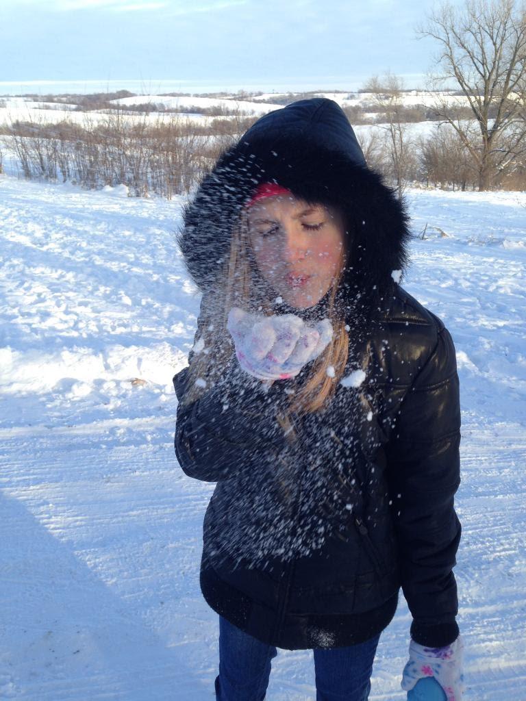 Ashlee-Blowing-Snow.jpg
