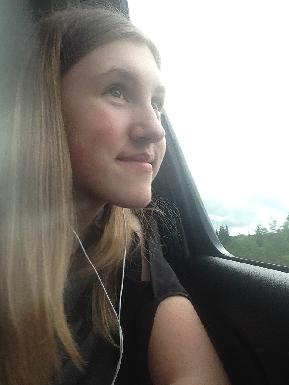 Ashlee-Looking-Out-Window-Canada-Trees.jpg