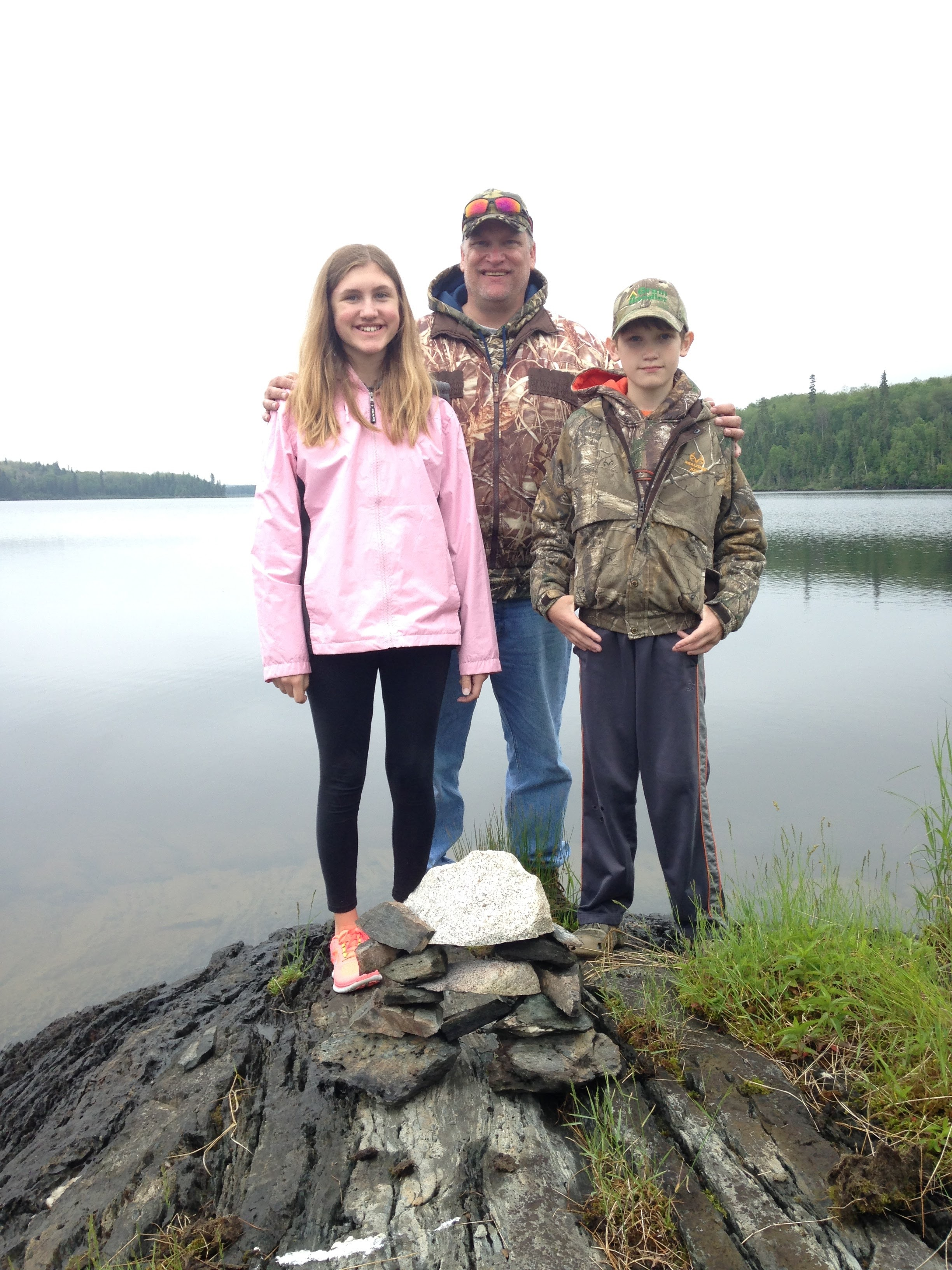 Siblings-and-Dad-with-Rock-Pile-Canada.jpg