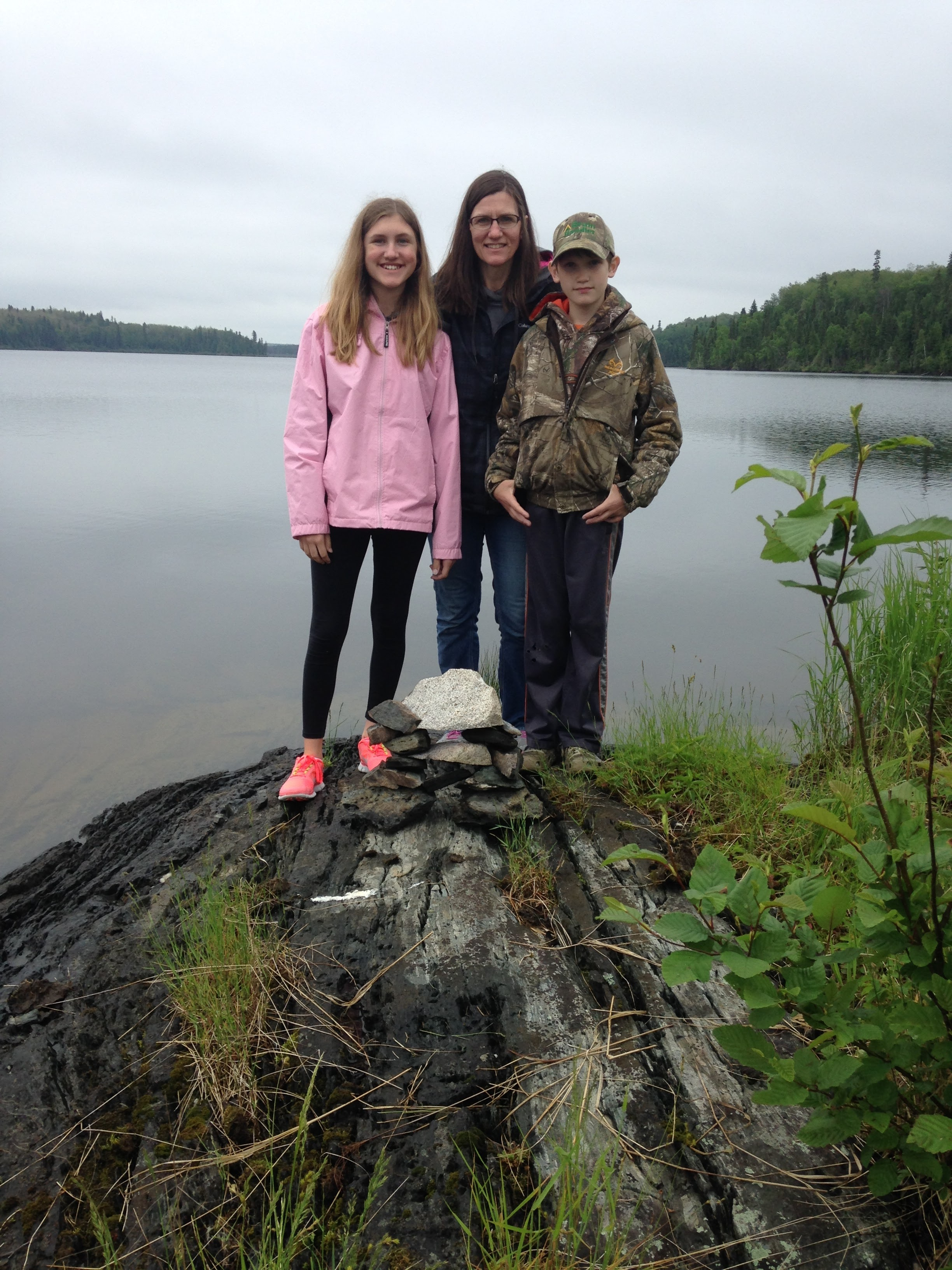 Siblings-and-Mom-with-Rock-Pile-Canada.jpg