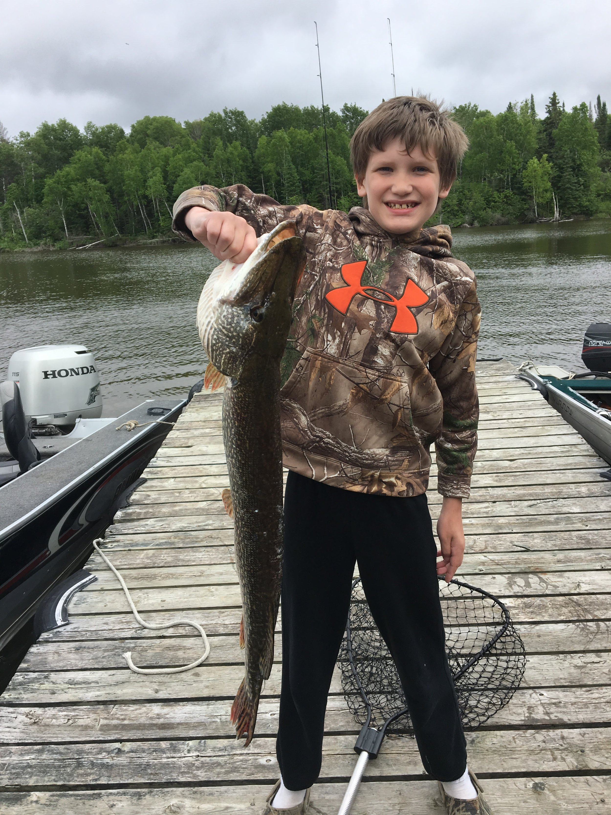 Hunter caught this fish off the dock by himself when our parents were out fishing; he did most of it on his own, and there were these guys next door who had just come back and helped us