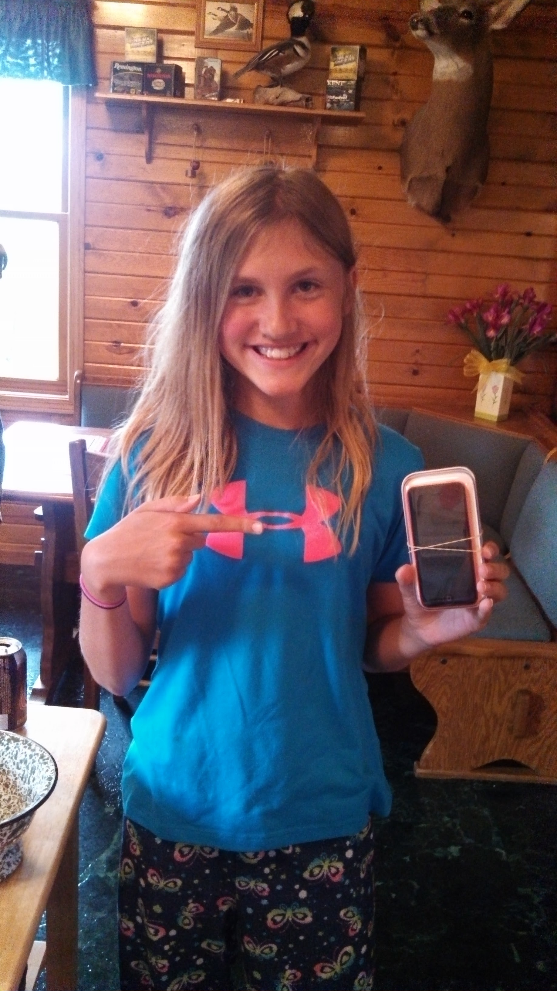 my first phone...the iPhone 5c—I was thrilled to get one in a coral color haha -
