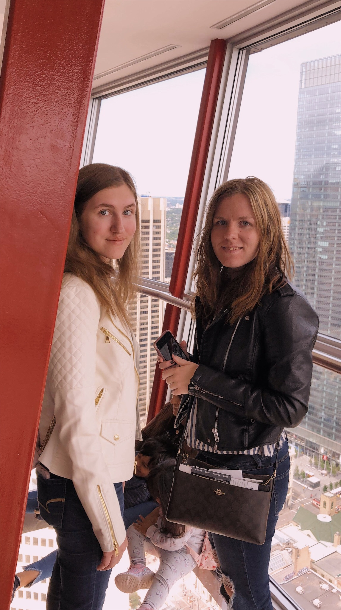 Ashlee and Kirsten in the Calgary Tower.jpg