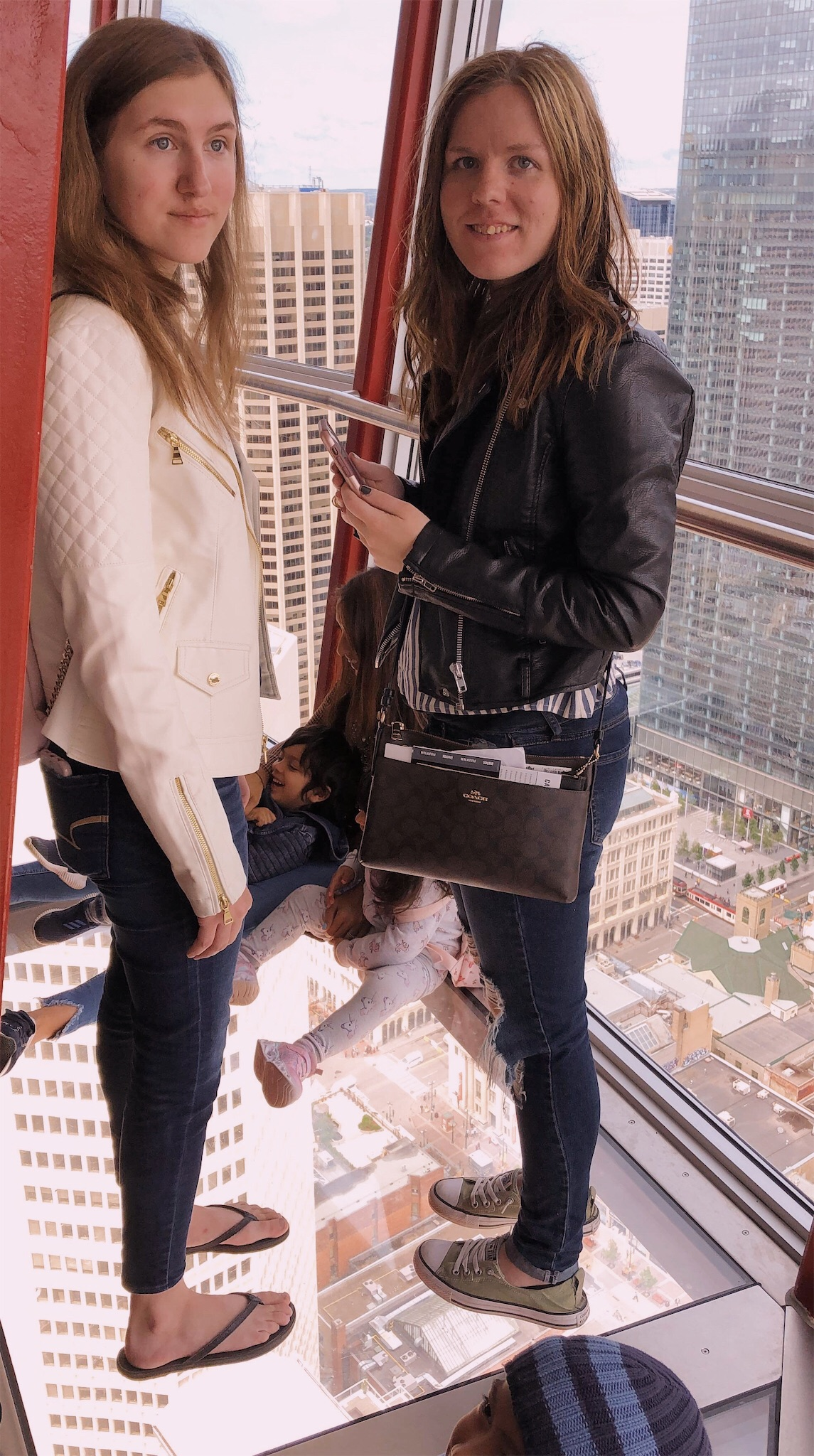 Ashlee and Kirsten looking out of the Calgary Tower.jpg