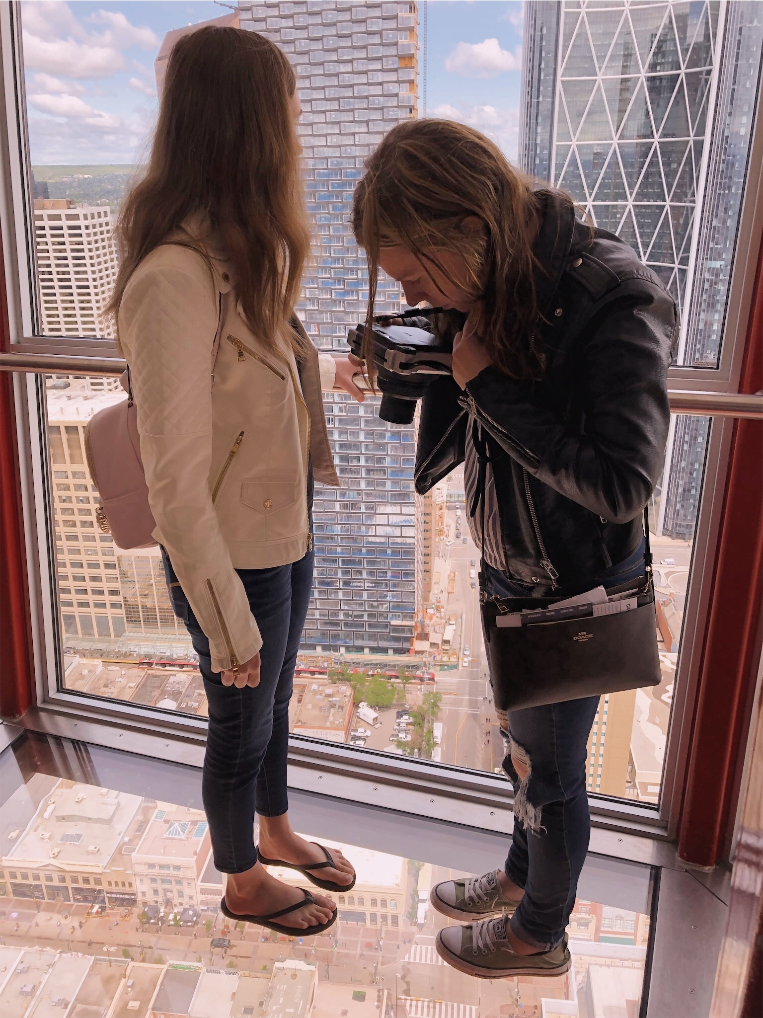 Ashlee and Kirsten taking photos in Calgary Tower.jpg