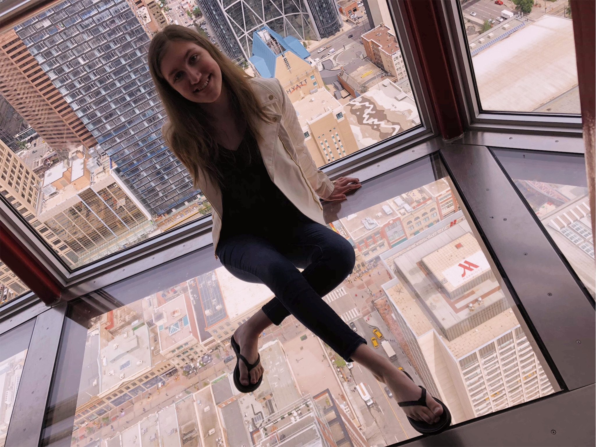 Ashlee sitting in the Calgary Tower.jpg