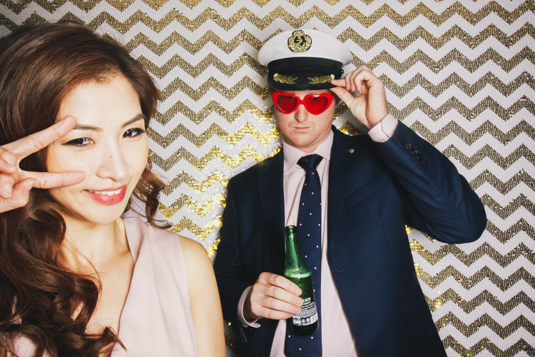 best-brisbane-friends-fun-gambaro-gold-hire-hotel-laughing-photo-booth-sailors-hat-wedding.jpg