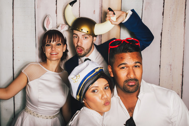 bride-and-groom-brisbane-photo-booth-hire-fun-gone-wild-party-pastel-wood-background-props-reception-wedding.jpg