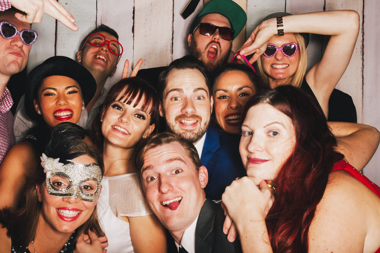 bride-and-groom-brisbane-photo-booth-hire-fun-gone-wild-party-pastel-wood-background-reception-wedding-2.jpg