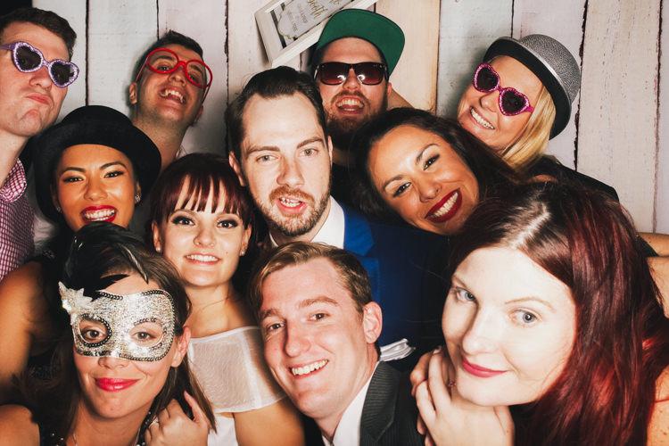 bride-and-groom-brisbane-photo-booth-hire-fun-gone-wild-party-pastel-wood-background-reception-wedding.jpg