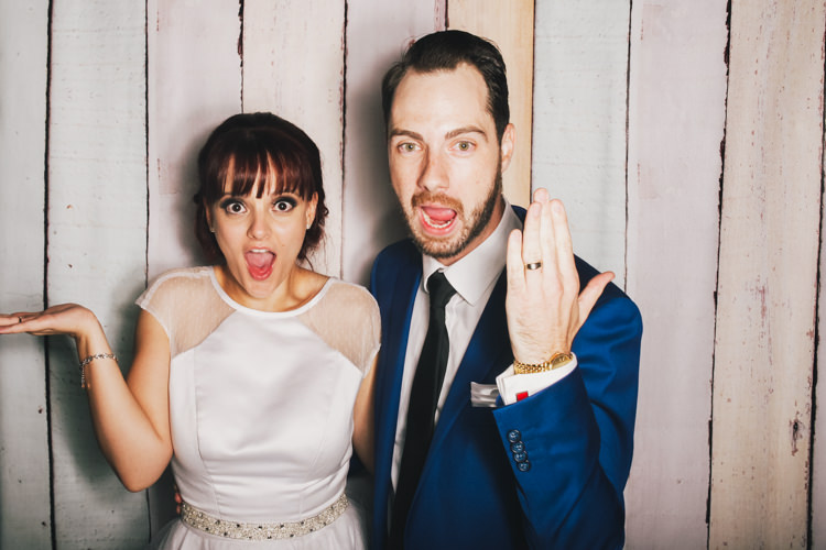 bride-and-groom-brisbane-photo-booth-hire-fun-party-pastel-wood-background-reception-wedding-2.jpg
