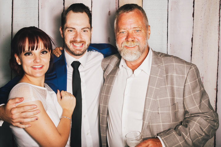 bride-and-groom-brisbane-photo-booth-hire-fun-party-pastel-wood-background-reception-wedding-3.jpg