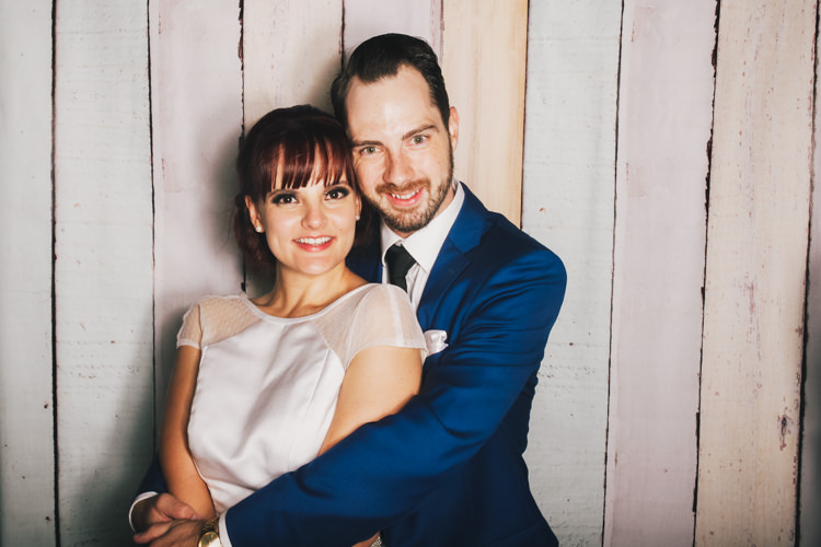bride-and-groom-brisbane-photo-booth-hire-fun-party-pastel-wood-background-reception-wedding-4.jpg