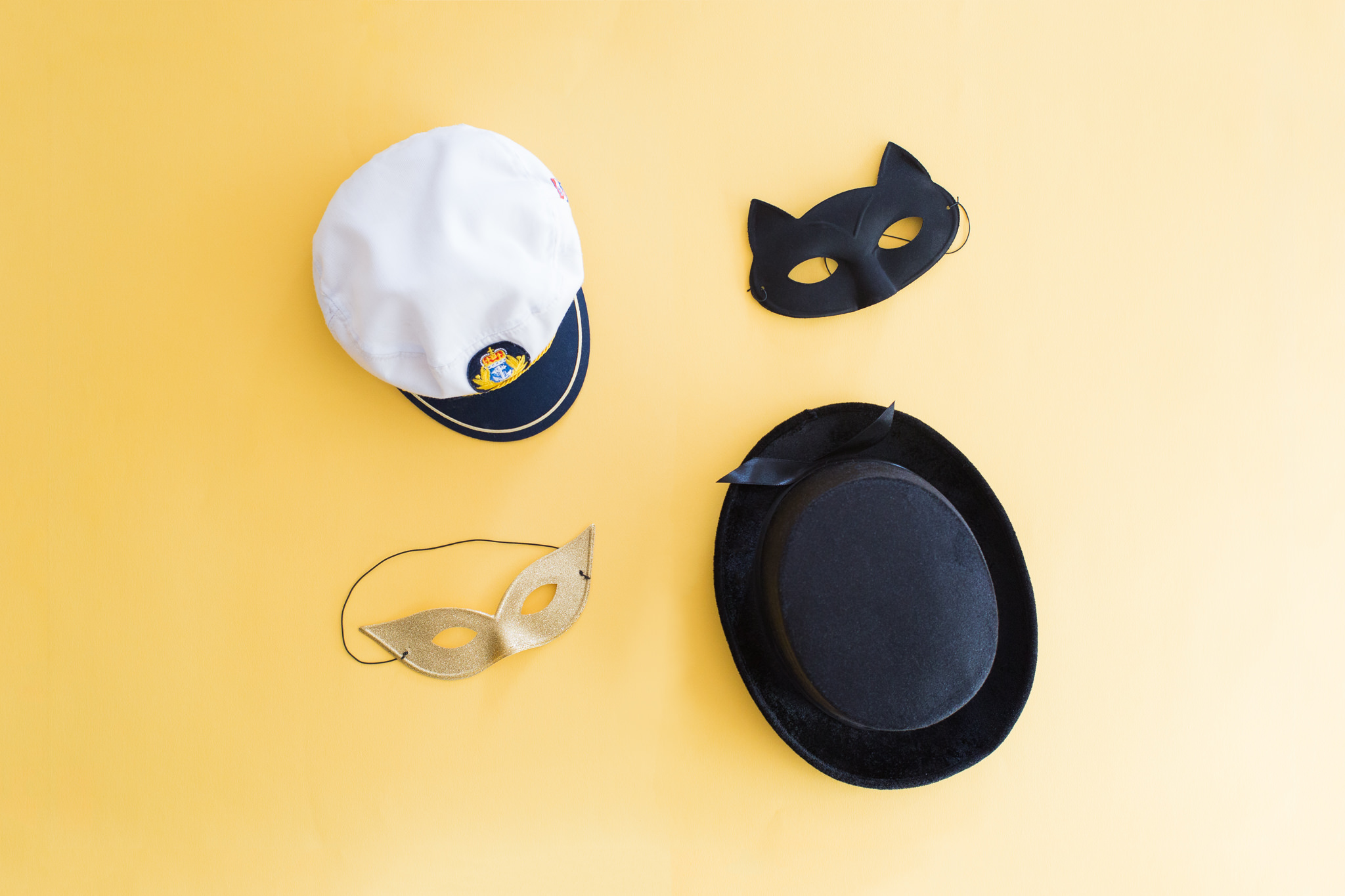 photo-booth-props-sydney-hire-corporate-marketing-brand-event-top-hat-black-tie-sailors-hat-gold-glitter-mask-cat-batman-yellow-brand-activation.jpg