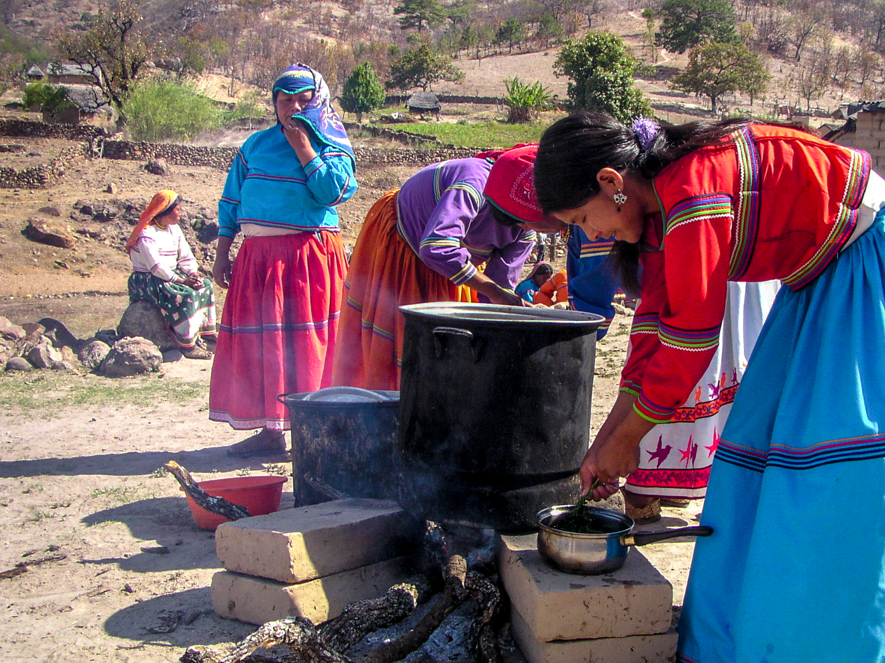 Ladies form the community cook some chicken soup to feed everyone