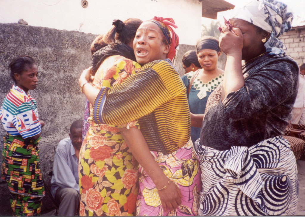 The death of a social worker at Fondation Femme Plus. She was HIV+. Here her bereaved friends burst into tears. © Christian Aid / PhotoVoice / Annie