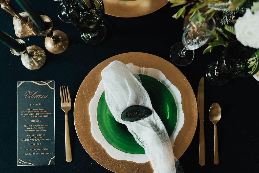 wedding and event tablescape using emerald velvet linens and gold silverware (photo by: Sam + Sola Studio)