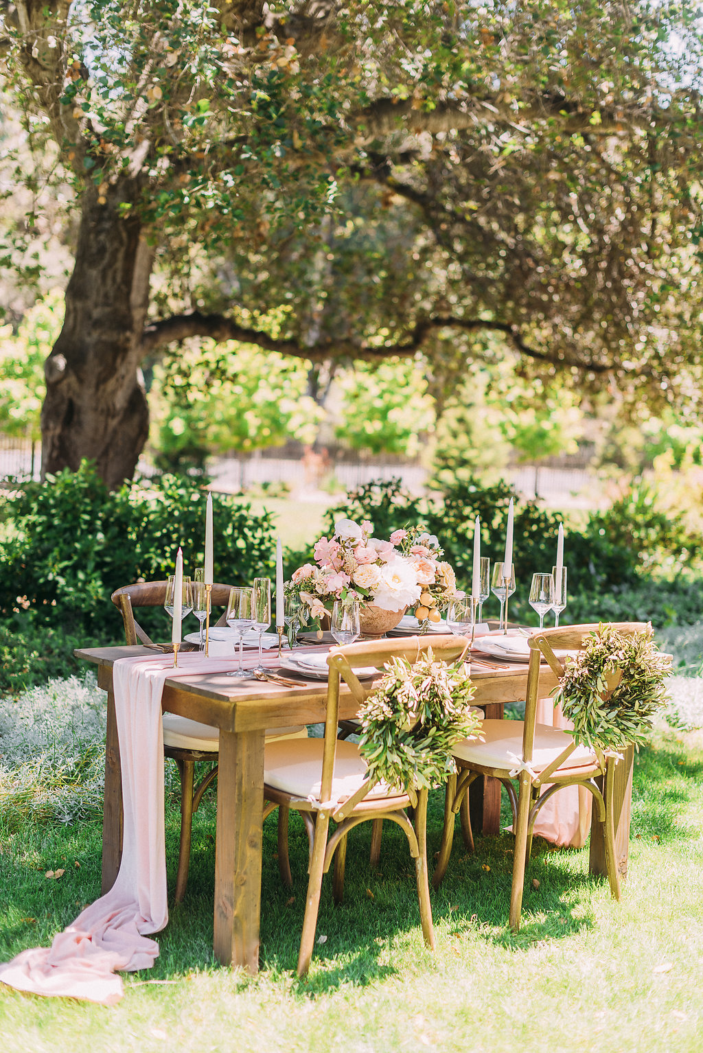 spring outdoor reception tablescape using long pink silk table runners