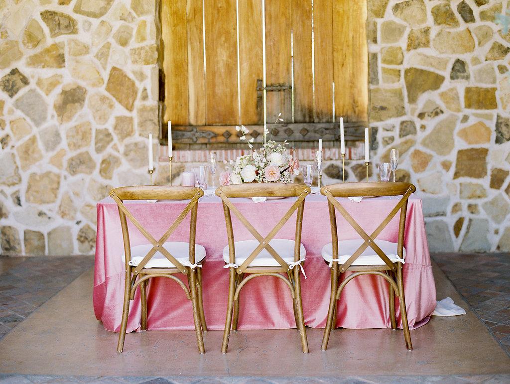Full view of floor-length Pink silk velvet table linen wedding tablescape