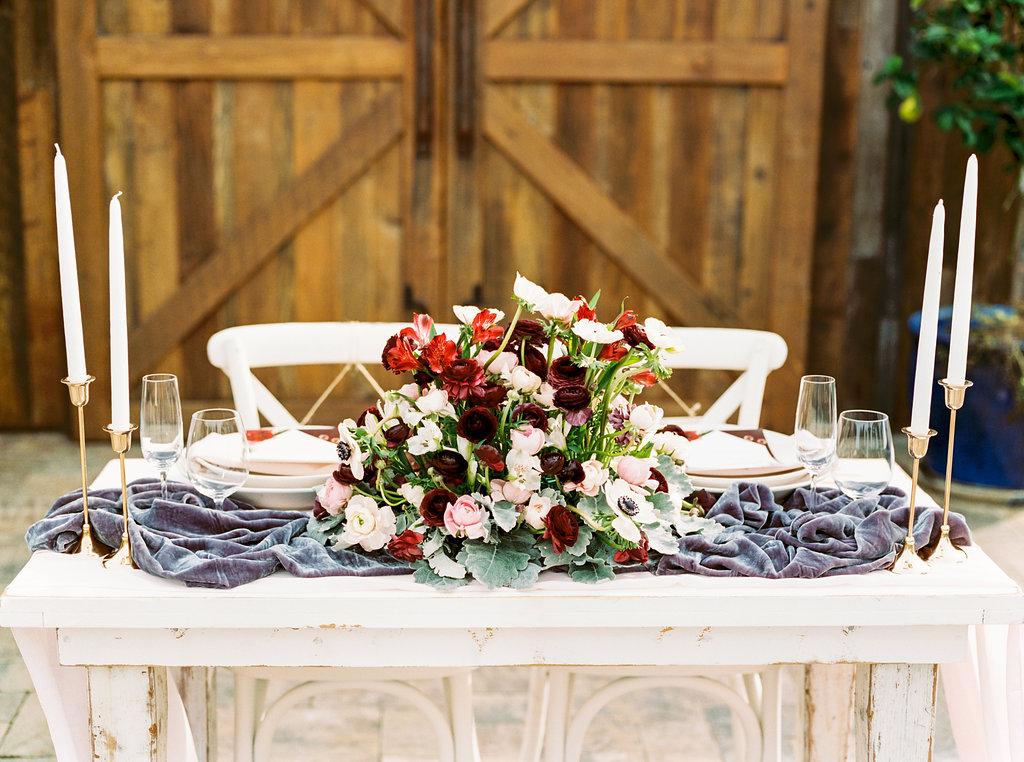 Gray silk velvet table runner with gorgeous floral arrangement