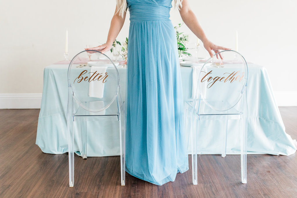 Pastel Blue flowy table linen and transparent chairs for pretty blue themed wedding tablescape