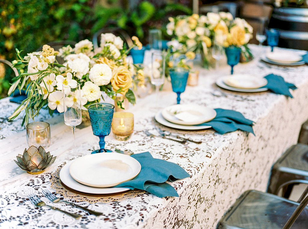 Lace table linen, silk chiffon table runners, and teal table napkins for modern wedding tablescapes