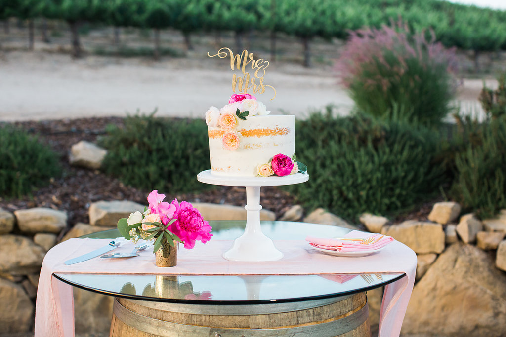 Pretty and unique wedding cake table using silk chiffon table runners