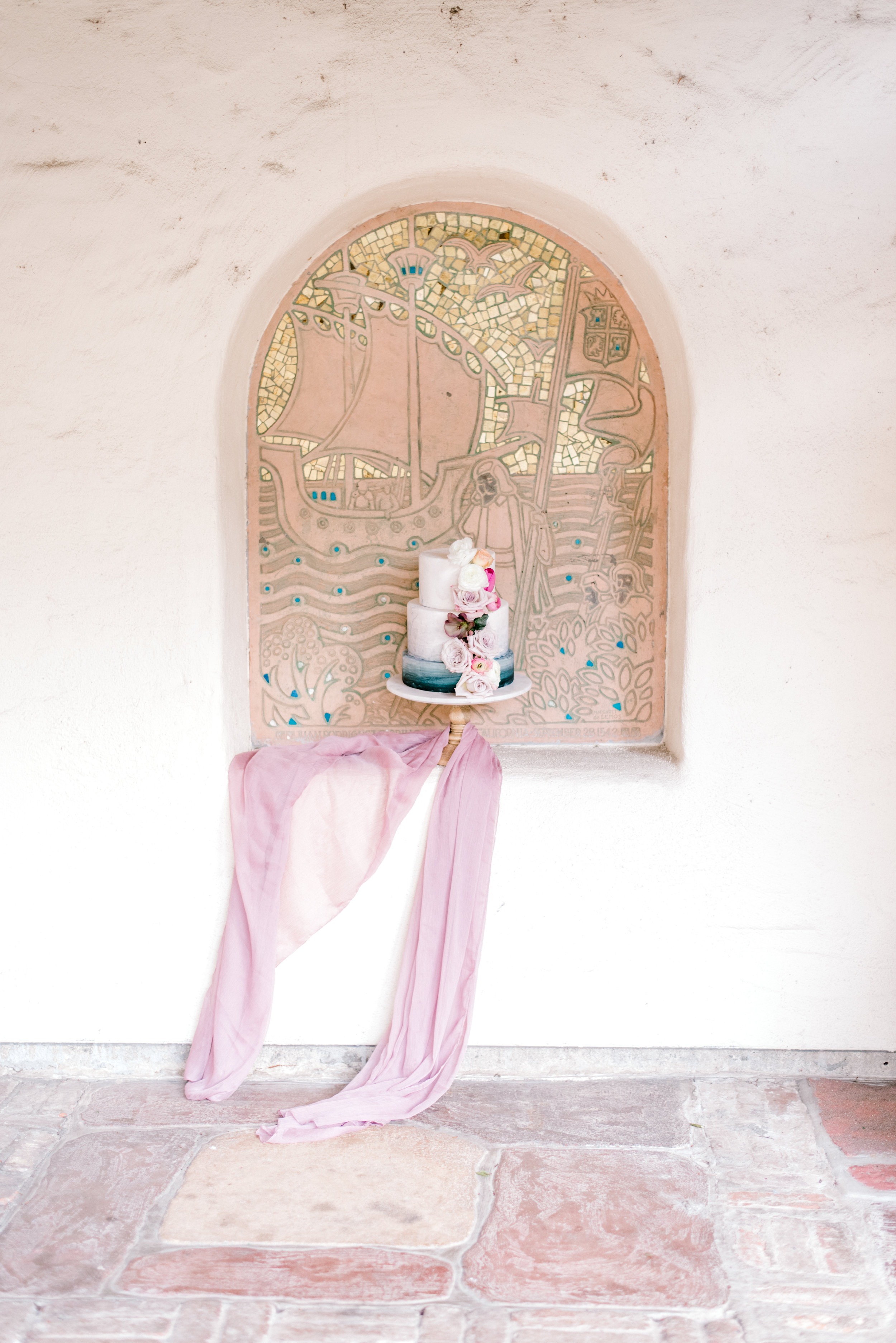 Wall design using wedding cake and silk chiffon table linen