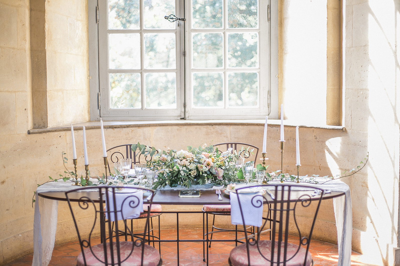 Simple castle wedding tablescape using silk table runners