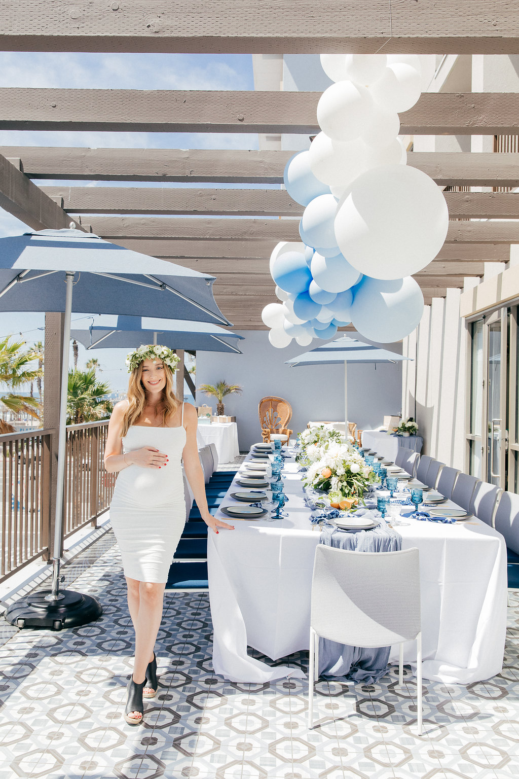 gorgeous tablescape with white linens and powder blue table runners for gorgeous blue and white themed baby shower