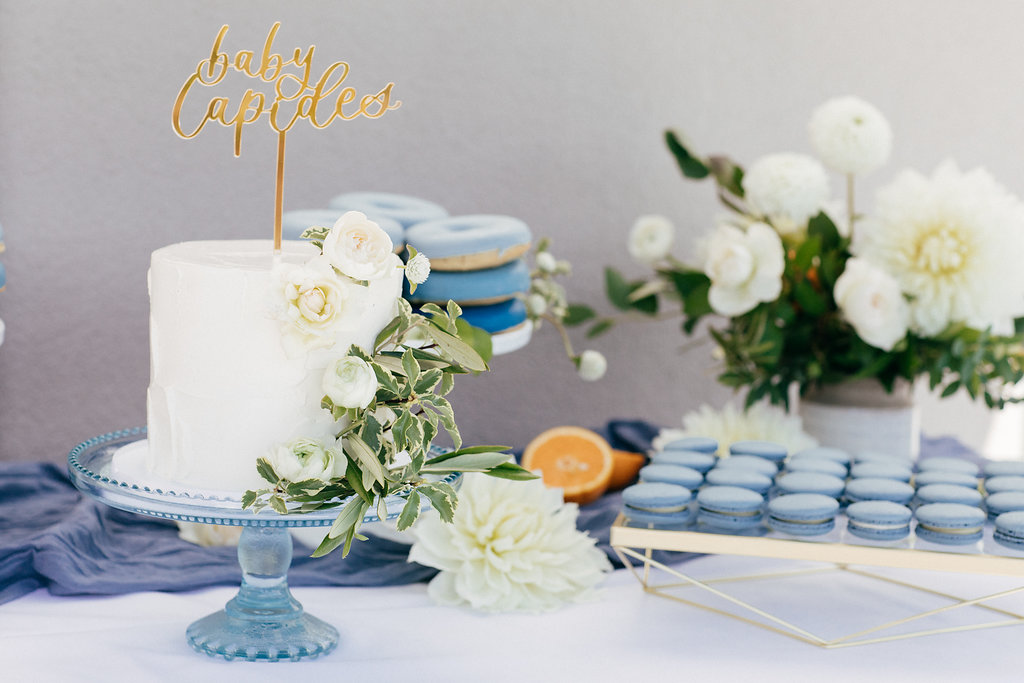 Blue-themed baby shower cake and dessert table