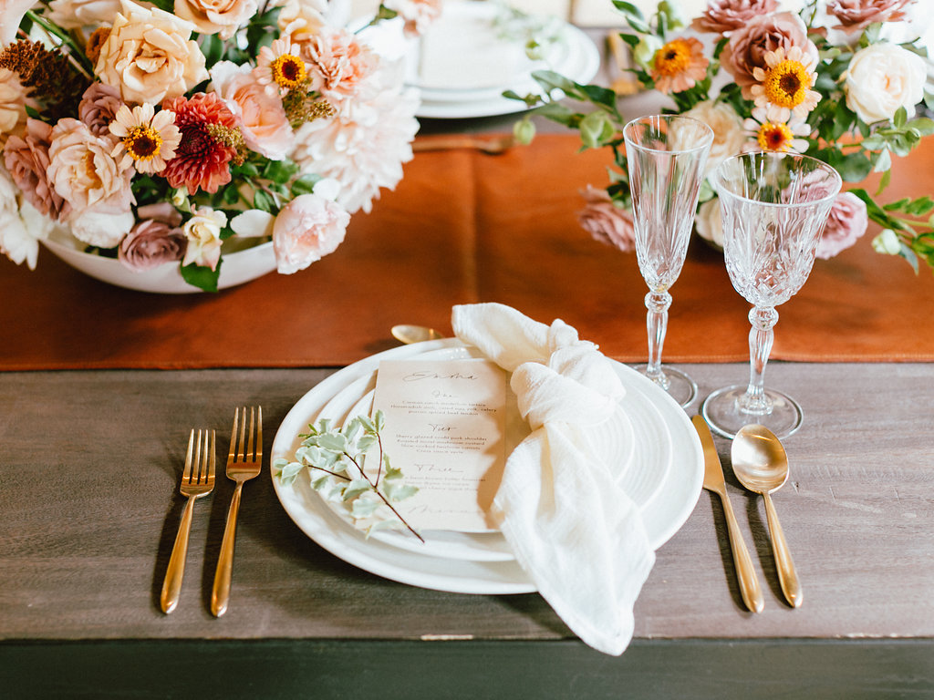 gorgeous and unique faux leather table runners with pretty floral arrangement for wedding tablescape