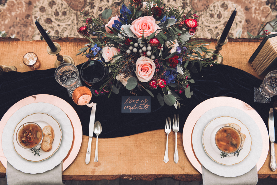 gorgeous and elegant wedding tablescape using dark blue silk velvet table runners