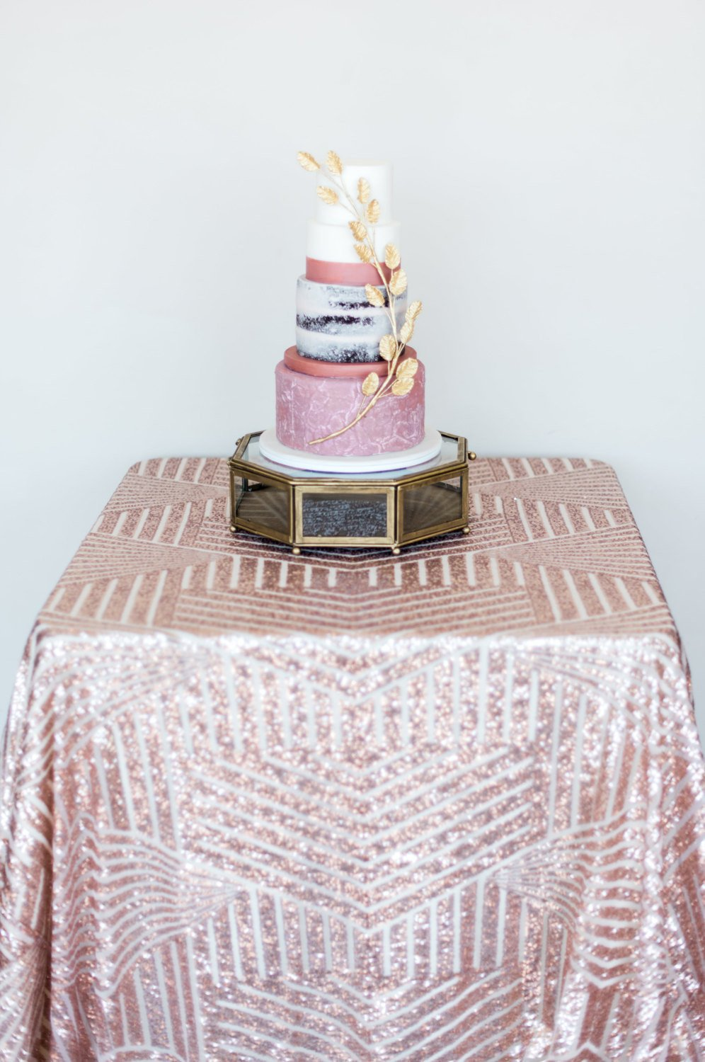 Rose gold sequin table cloth for creative and gorgeous wedding cake table