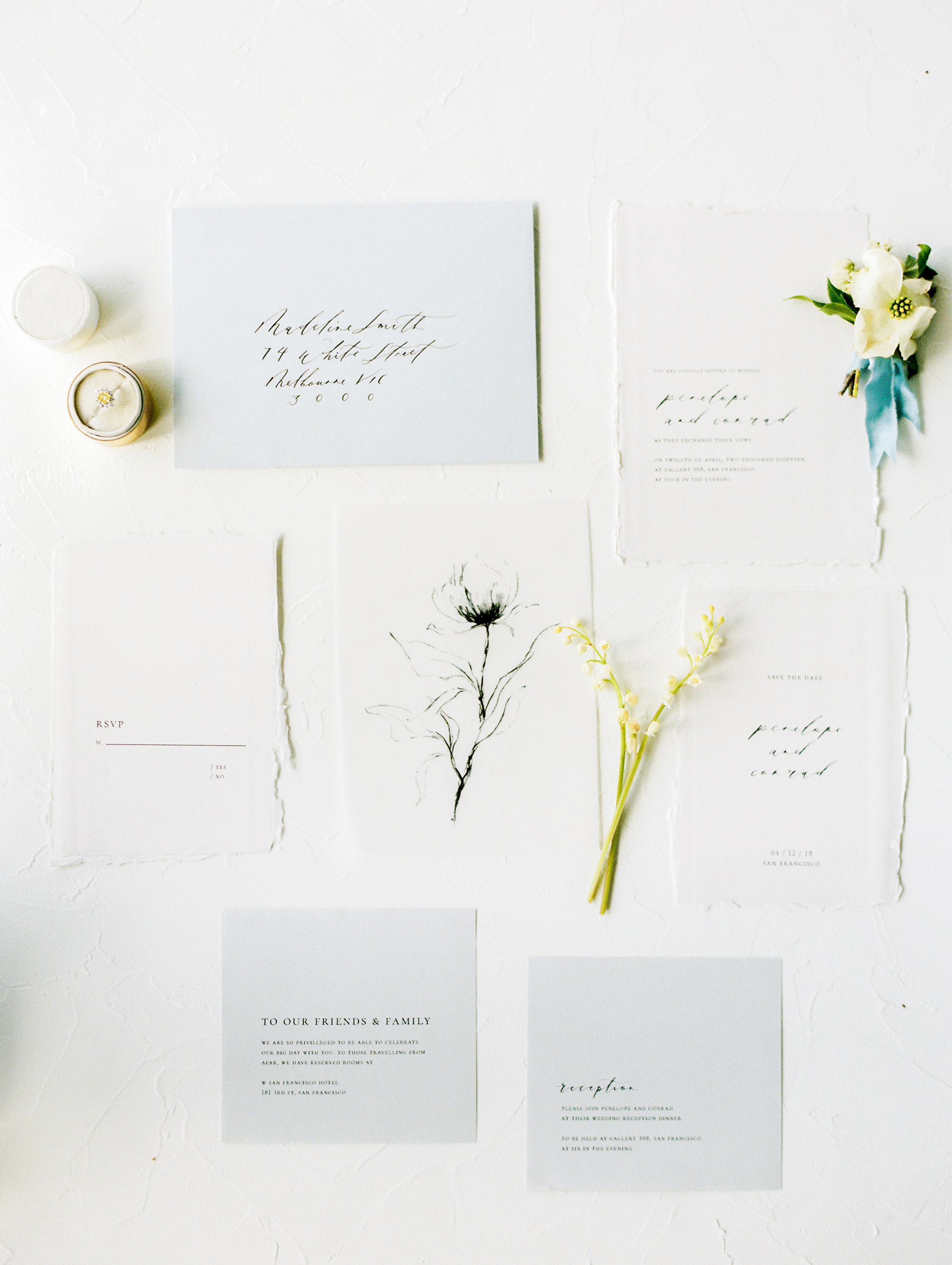 Wedding Invitation Calligraphy Suite Flatlay with gorgeous blooms and silk velvet ribbon