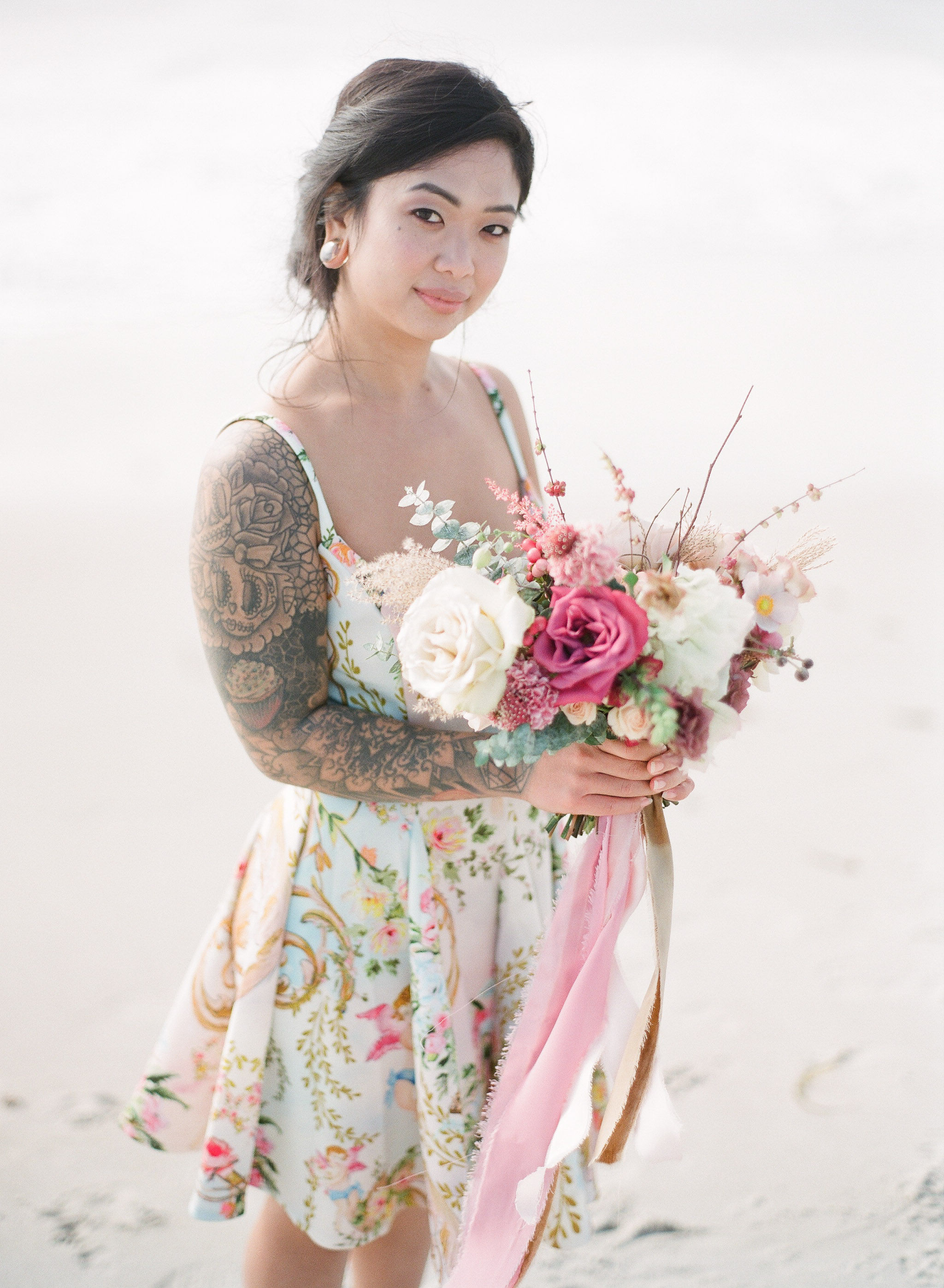 Bridesmaid dress and Pretty floral bouquet with flowy silk ribbons for beach wedding