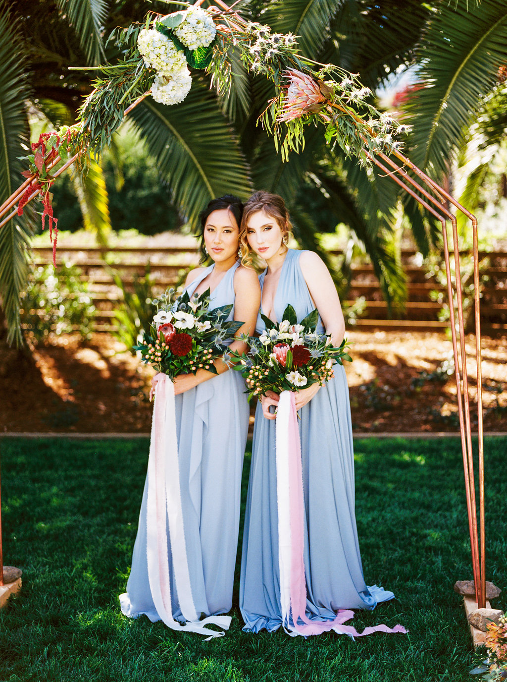 Light Blue Bridesmaid Dresses with Gorgeous Floral Bouquets that has long and flowy silk ribbons