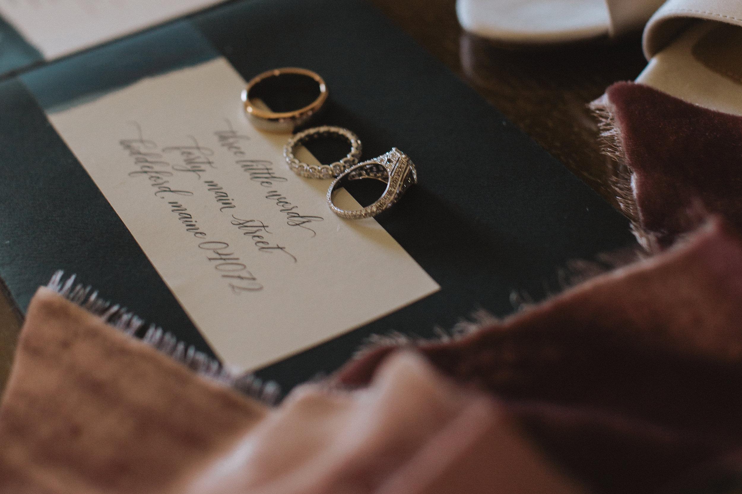 Vintage wedding invitation calligraphy with gorgeous silk velvet ribbon flatlay