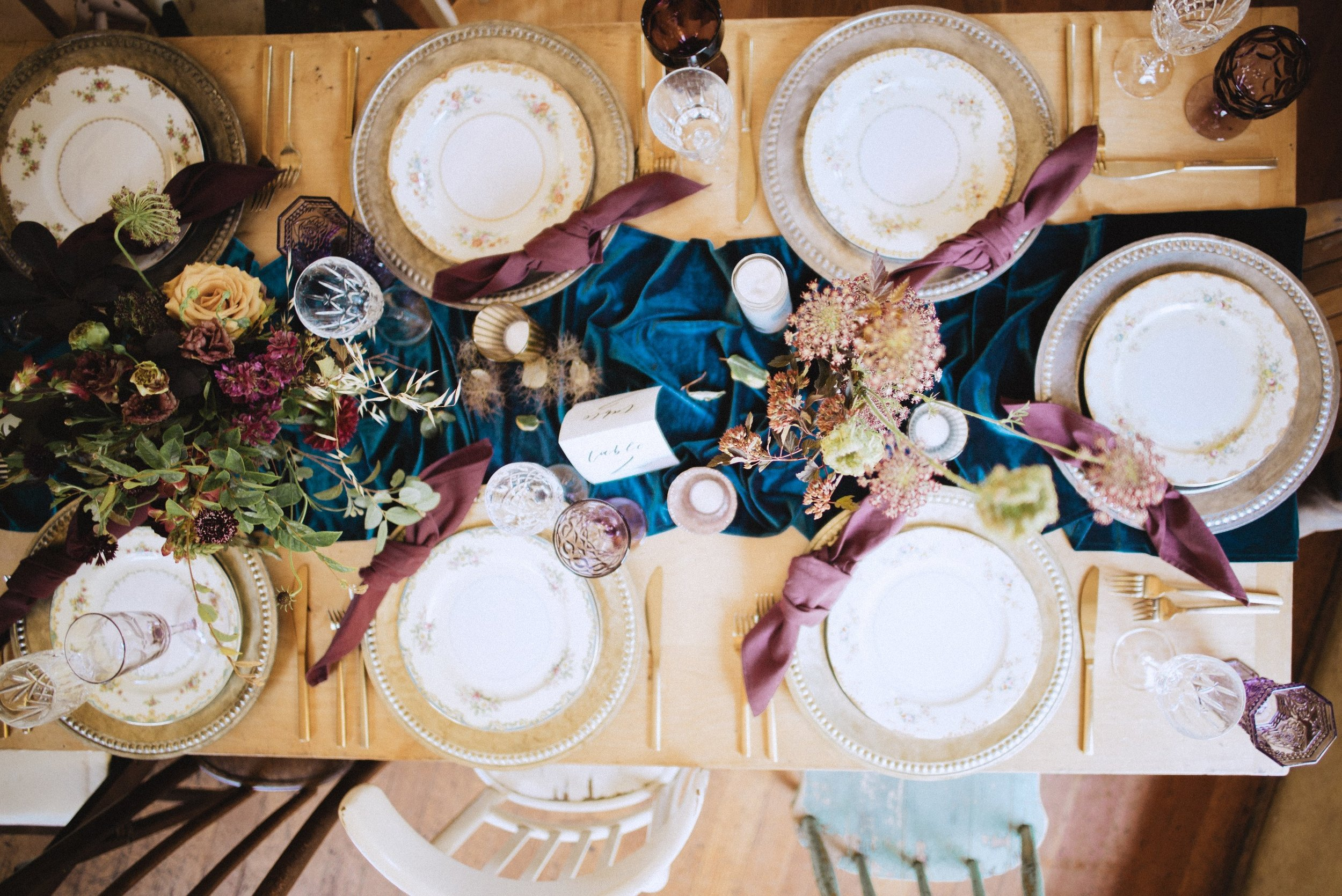 gorgeous vintage wedding tablescape with pretty blue velvet table runner