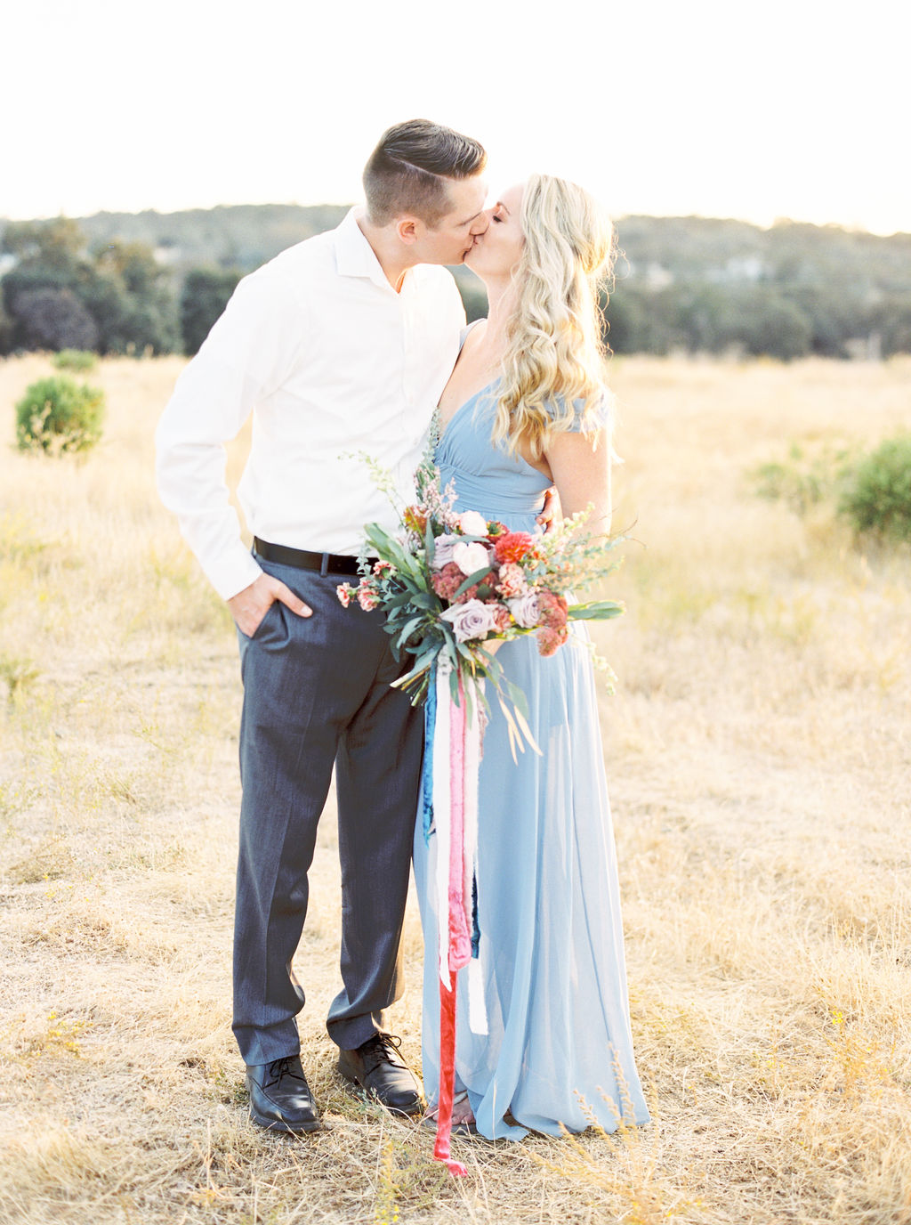 fun and pretty engagement shoot with bouquet and colorful silk velvet ribbons