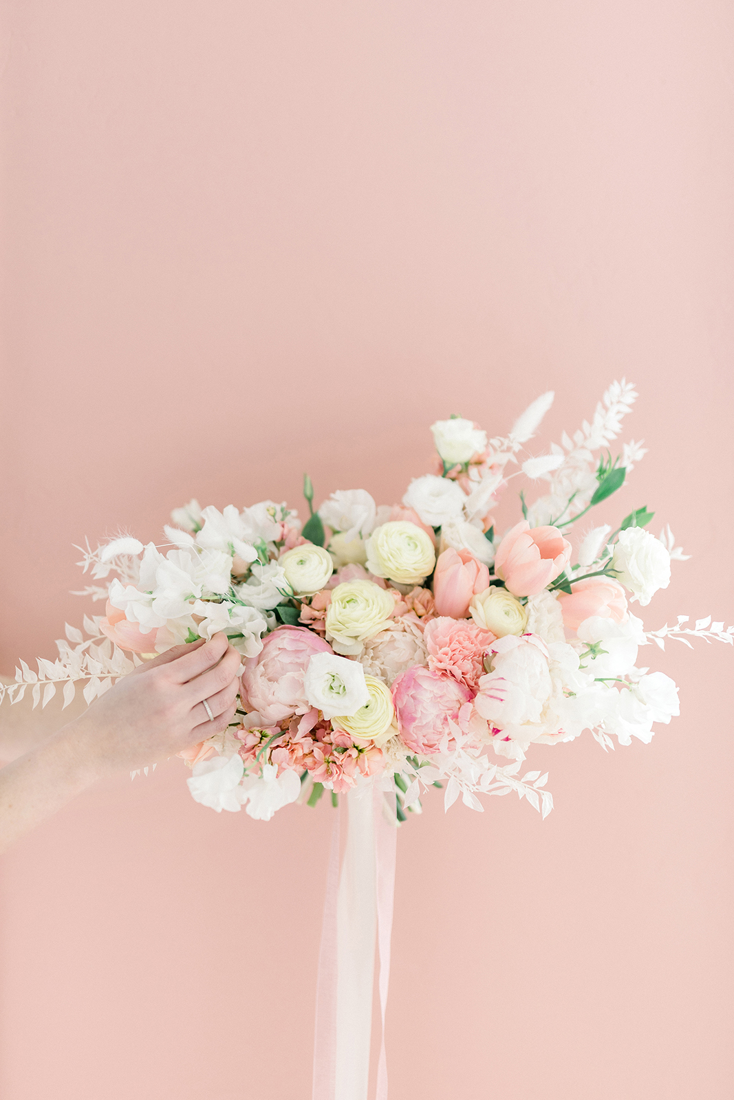 PInk, white, and peony bridal bouquet inspiration with pretty and flowy silk ribbons