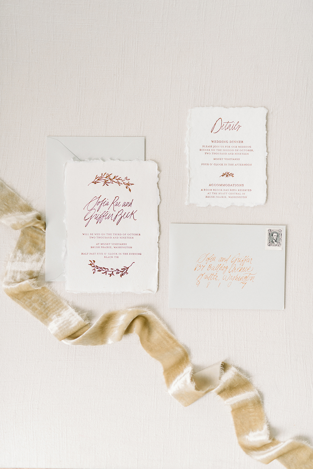 simple and pretty wedding invitation calligraphy flat lay with gorgeous silk velvet ribbon flatlay