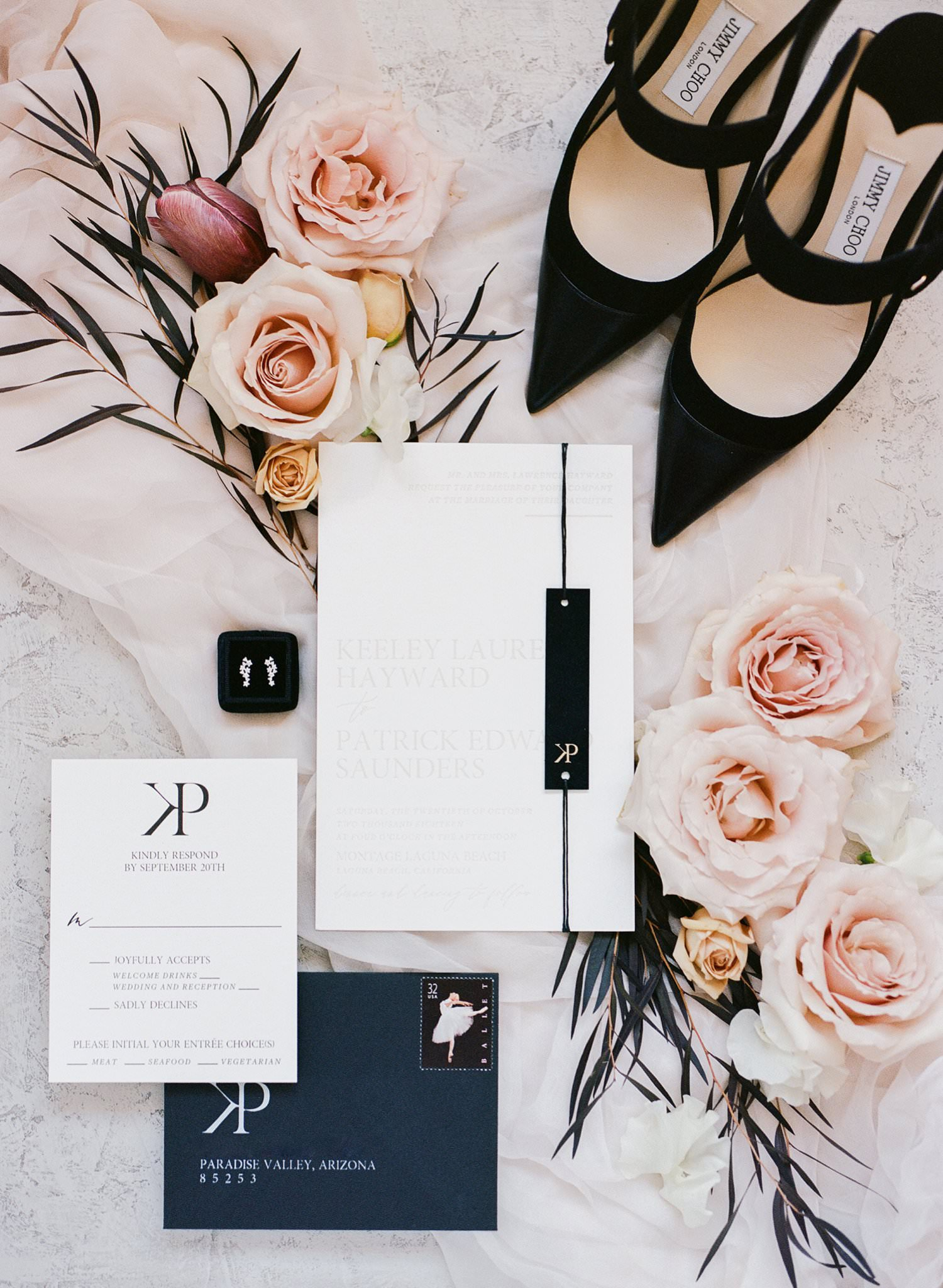 wedding invites and wedding shoes flatlay with pretty florals and silk chiffon linen