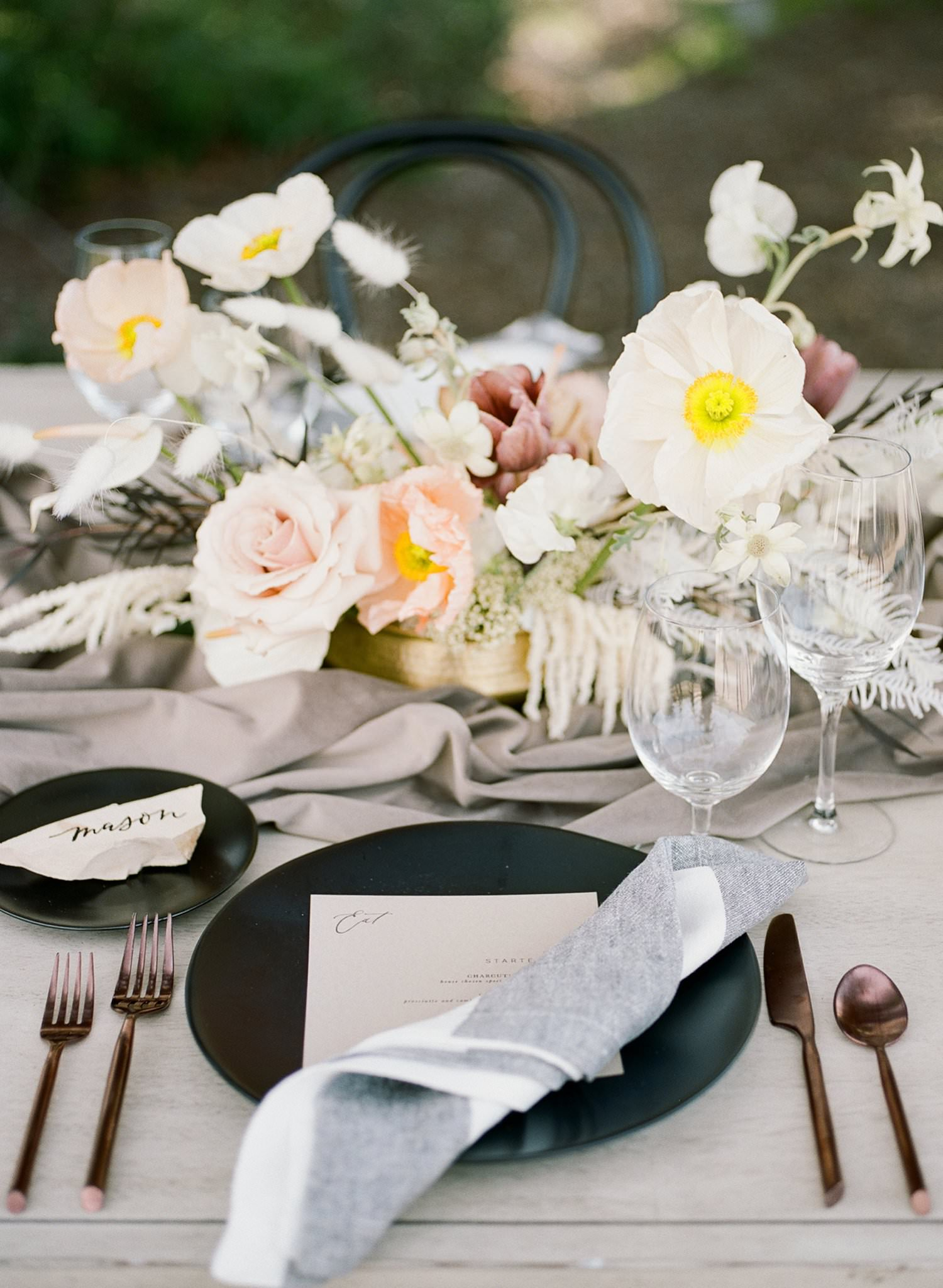 dark colored tableware and gray table runners for fine art wedding tablescape