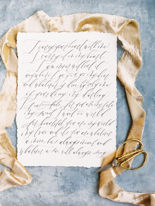 wedding flatlay photography with gold silk velvet ribbon